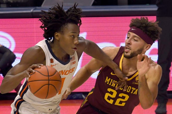 Illinois guard Ayo Dosunmu (11) powers past Minnesota's guard Gabe Kalscheur (22) in the second half of an NCAA college basketball game Tuesday, Dec. 15, 2020, in Champaign, Ill. (AP Photo/Holly Hart)