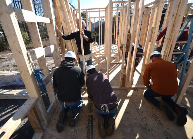 A group of volunteers work on the Cape Fear Habitat For Humanity CEO build off Gordon Road in Wilmington, N.C., Feb. 1, 2019. Volunteers included several Wilmington area CEO's and business leaders.