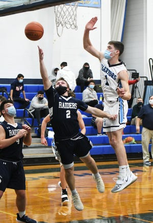 Ethan Robidoux takes it up strong to finish the drive against Seekonk during an SCC match-up back on Jan. 19. Seekonk to the win, 74-65.