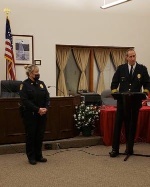 Springfield Township Police Department Chief Jack Simone (right) announces the promotion of Denise Moore to captain.