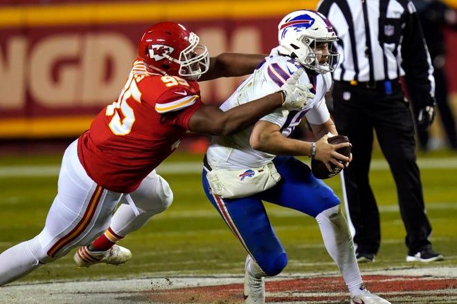 Kansas City Chiefs defensive tackle Chris Jones, left, tackles Buffalo Bills quarterback Josh Allen during the second half of the AFC championship NFL football game Sunday in Kansas City, Mo.