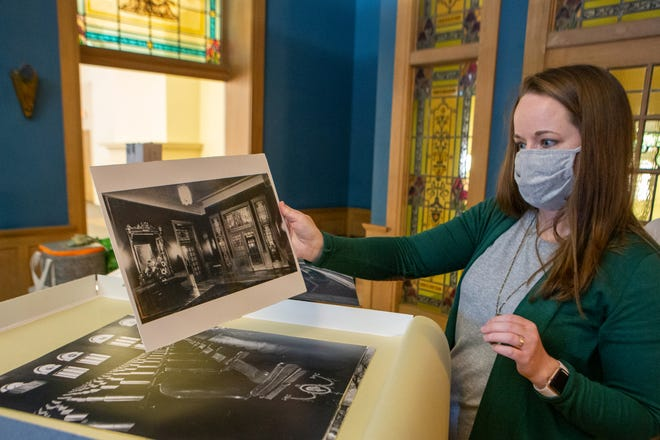 Courtney Stemler looks through old photographs of the historic Woman's Club of Topeka building, at 420 S.W. 9th St., late last year. Stemler, along with three other business partners, purchased the building from auction and plan to turn the space into an event venue named The Beacon.