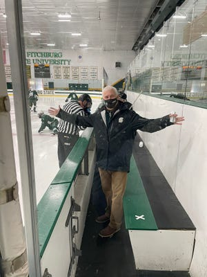 Oakmont principal Dave Uminski stepped back behind the Spartans bench for a couple of hockey games this season.