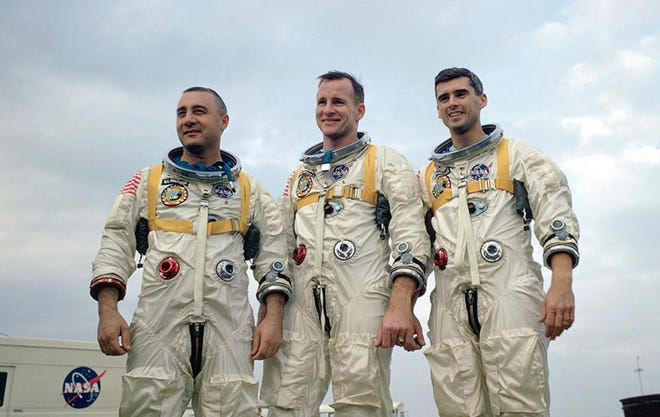 "This undated file photo provided by NASA shows the Apollo 1 crew at an undisclosed location. From left: astronauts Virgil ""Gus"" Grissom, Edward H. White II and Roger B. Chaffee. All three perished after a fire broke out inside the Apollo 1 module during a launch rehearsal on Jan. 27, 1967, at the Cape Canaveral Air Force Station, Fla."