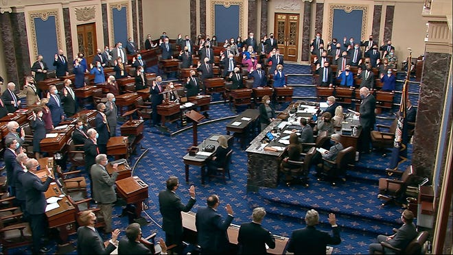 In this image from video, Sen. Patrick Leahy, D-Vt., the president pro tempore of the Senate, who is presiding over the impeachment trial of former President Donald Trump, swears in members of the Senate for the trial at the U.S. Capitol in Washington on Tuesday.
