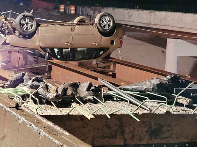 A 29-year-old Dover man was injured when his car overturned on the beams of an Interstate 77 bridge undergoing construction above state Route 212 NE in Bolivar early Tuesday.
