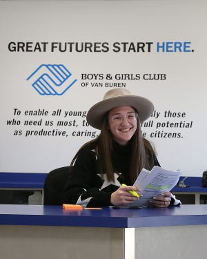 Cedarville Bys & Girls Club Unit Director Codee Garrett checks in club members at the Van Buren Boys & Girls Club, 1400 City Park Road, Tuesday, Jan. 26.