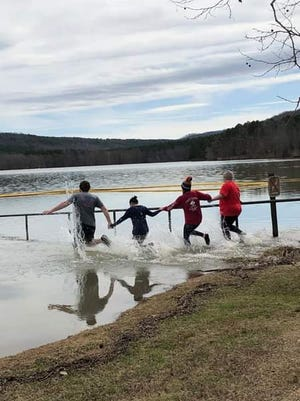 At this year's Logan County Polar Plunge on Feb. 13, participants will run into Cove Lake, dunking their bodies in the winter water. Logan County residents are seen here at Cove Lake in the 2020 Polar Plunge.