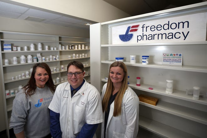 Nate Hux, center, opened Freedom Pharmacy, 641 Hill Road N., Suite C, in December next to Pickerington Pharmacy, which he also owns. Also in the photo are Jessica Ayres, office manager, and Kristen Pfeiffer, pharmacist in charge.