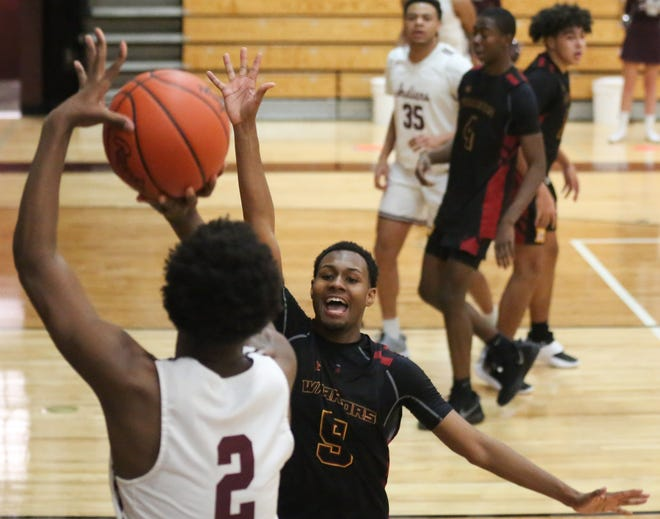 North's Semaj Council defends Canal Winchester's Abdoulaye Diallo earlier this season. The Warriors had won four of five games before playing South on Jan. 29. They were 6-6 overall and 5-3 in the OCC-Capital.