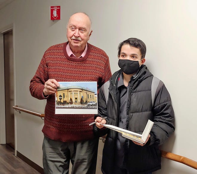 Allegany County legislator Bill Dibble, left, with support from Matthew Sanders presented an idea to the village board Monday night to donate the Municipal Building to the David A. Howe Public Library.