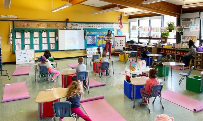 Kindergarten teacher Sarah Mattera reads to her class at the Winthrop Elementary School.