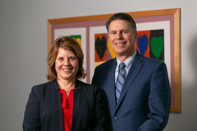 Outgoing President Dave Manzo and his successor, Bridget Irish.
