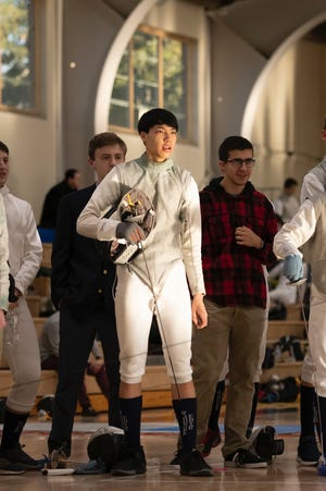 As the Eagles fencing captain this winter, senior Thomas Ligh of Peabody is focused on sharing his passion for the sport with his younger teammates, which involves cheering them on  with gusto.
