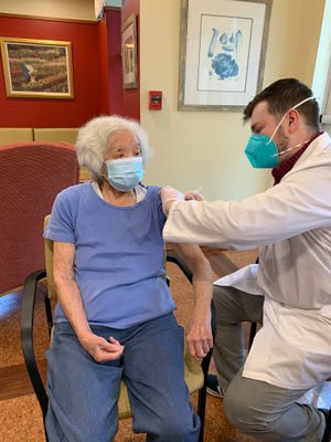Marjorie Eng, 101, gets the first COVID-19 vaccine on Jan. 17 at Youville Place Assisted Living in Lexington.