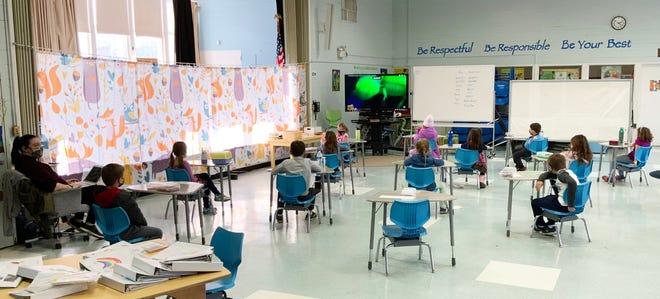 First-grade teacher Rebecca Pinciaro teachers her class in the converted cafeteria at Cutler Elementary School.