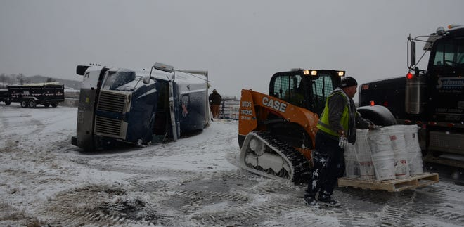 Crews spent several hours clearing buckets of paint and the wreckage of a semi after a crash Tuesday on the ramp from eastbound I-94 to 11-Mile Road in Emmett Township.  (Trace Christenson/The Enquirer)