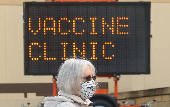 Shirley Wall, of Port Orchard, waits in line for the first community COVID-19 vaccine clinic in Kitsap County at the former St. Michael Medical Center in East Bremerton on Tuesday, Jan. 26, 2021.