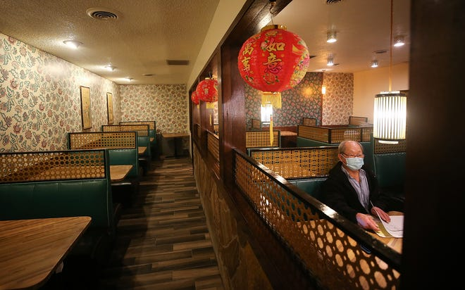 FILE — Golden Star owner Pun Liu talks about renovations to his Bremerton restaurant in January. Restaurants will no longer face capacity or distancing restrictions when Washington state drops limitations it adopted after the COVID-19 pandemic hit in 2020.