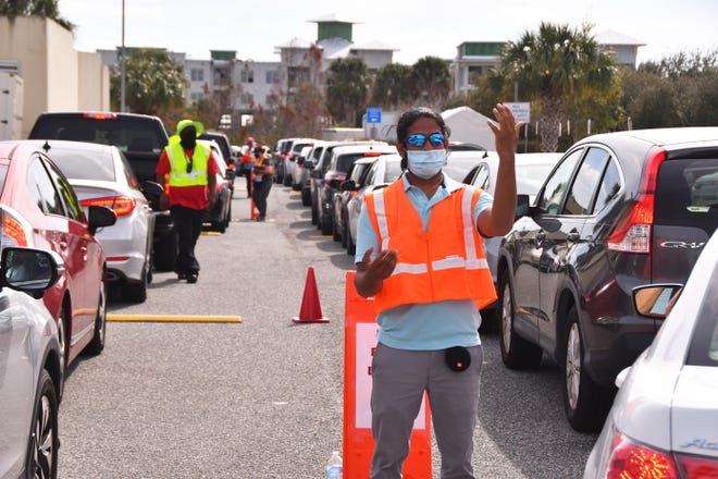 People were lined up in their vehicles Tuesday at the drive-thru COVID-19 vaccination program at the Florida Department of Health's  complex in Viera.