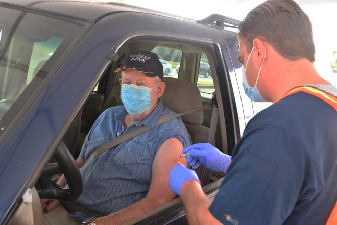 COVID-19 vaccinations are administered at a drive-thru site outside the Florida Department of Health complex in Viera.