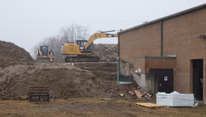Despite the damp fog, work continues at the Bucyrus Area YMCA on Tuesday. Crews are preparing for the installation of a new HVAC system.
