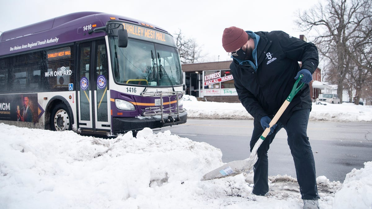 Photos: Residents shovel snow from DART stops, wanting the city to act