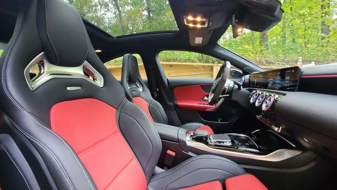 The interior of the 2020 Mercedes-AMG CLA 63 is optioned with sport seats and a sunroof.