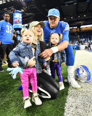 Detroit Lions quarterback Matthew Stafford poses for a picture before the game with wife Kelly and daughters Chandler, Sawyer and new baby Hunter at Ford Field in Detroit on October 28, 2018.