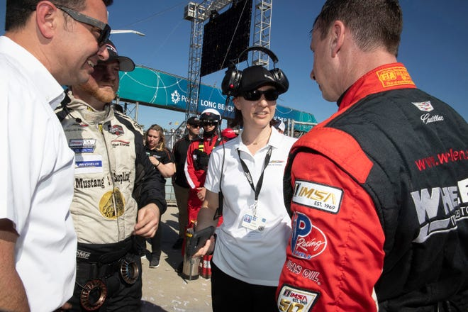 Laura Klauser (center, right) is GM's new Sports Car Racing Program Manager overseeing Corvette, Cadillac, and Camaro IMSA race programs.