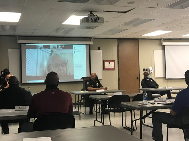 Lafayette City Marshal Reggie Thomas, center, and Lafayette Police Chief, right, lead a Community Relations Committee meeting on Jan. 25, 2021, at the Lafayette Police Department