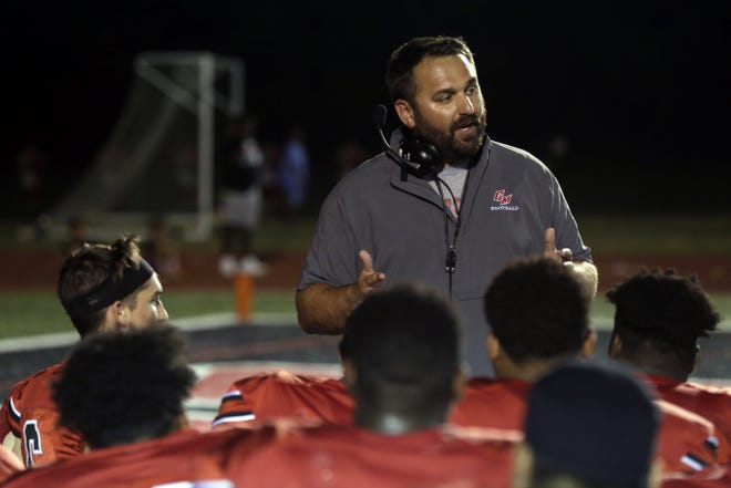 Former Groveport coach Bryan Schoonover is shown talking to his team after a 19-14 win over Pickerington Central on Sept. 20, 2019, was hired as Lancaster's new head football coach Tuesday afternoon.