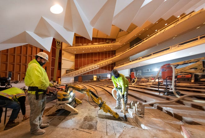 Workers with Interstate Sawing remove concrete for additional handicapped seating as part of a $4 million renovation project Friday, January 22, 2021 at the Marcus Center for the Performing Arts in Milwaukee, Wis. In the center's previous configuration were six ADA seats of the total 2,305 seats. After the renovation, which will include four additional aisles on the main floor, there will be 18 ADA seats and a total of 2,110 seats. All new seats will in installed throughout the entire hall.  The new seats are similar in size  to the old ones but will have a bit more generous seat width.