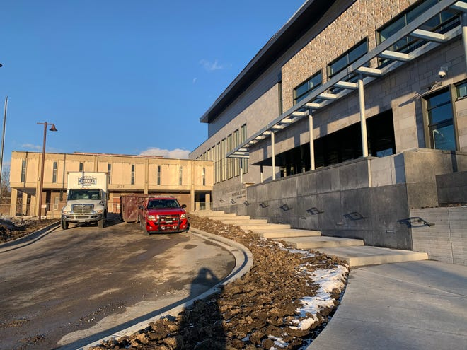 The new, now-completed Waukesha City Hall dwarfs the old building, left, for which demolition will soon begin. The new building, which opened Jan. 25, will be the subject of a virtual tour and ceremonies on Feb. 4.
