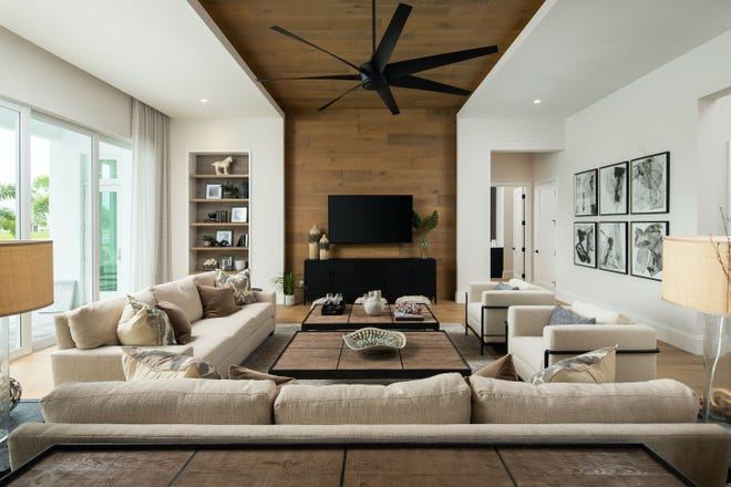 Theory Design's Ruta Menaghlazi, Adriene Ged, and Cynde Thompson created a coastal beach style design with a casually elegant feeling for Seagate Development Group's completed Monaco model at Esplanade Lake Club.
