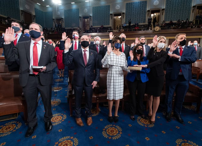 Congresswoman Yvette Herrell, R-N.M. (center, in white), is sworn into the U.S. House of Representatives as a New Mexico representative for the 2nd congressional district on Jan. 4, 2021.