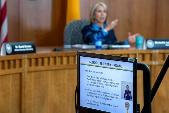 In this July 23, 2020, file photo, New Mexico Gov. Michelle Lujan Grisham talks about schools during an update on a COVID-19 broadcast from the state Capitol in Santa Fe.