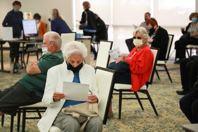 Eisenhower Health patients wait 15 minutes after receiving the Pfizer COVID-19 vaccine on Tuesday, January 26, 2021, in Rancho Mirage, Calif.