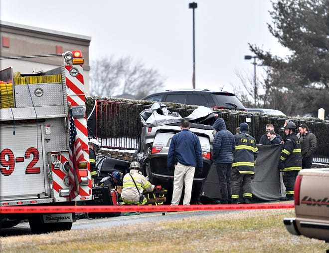 Officials work the scene of a single vehicle accident on Queenswood Drive in York Township, Tuesday, Jan. 26, 2021. York County Coroner was called to the scene. Dawn J. Sagert photo