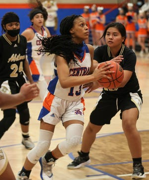 San Angelo Central's Neveah Hearne, 13, makes a move toward the basket during a District 2-6A game against Abilene High at Babe Didrikson Gym on Monday, Jan. 25, 2021.
