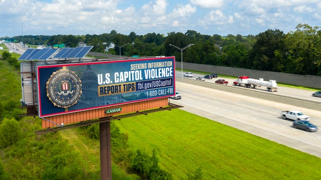 """Outdoor advertising company Lamar participates in an FBI program to display billboard ads like this one, shown in a publicity """"mockup."""" Ads like this one seeking tips on the events of Jan. 6, 2021 at the U.S. Capitol ran on 11 digital billboards in Springfield, Mo. from Jan. 14 through Jan. 24, 2021."""