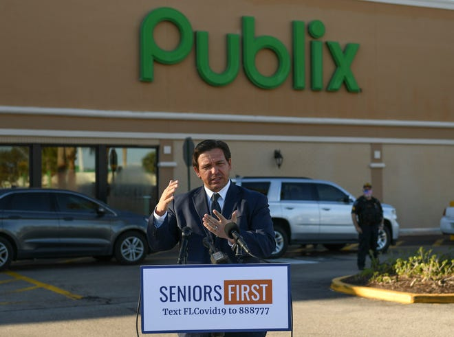 Florida Governor Ron DeSantis holds a media briefing concerning the COVID-19 vaccines at the Publix Supermarket at Treasure Coast Plaza on Tuesday, January 26, 2021, in Vero Beach.