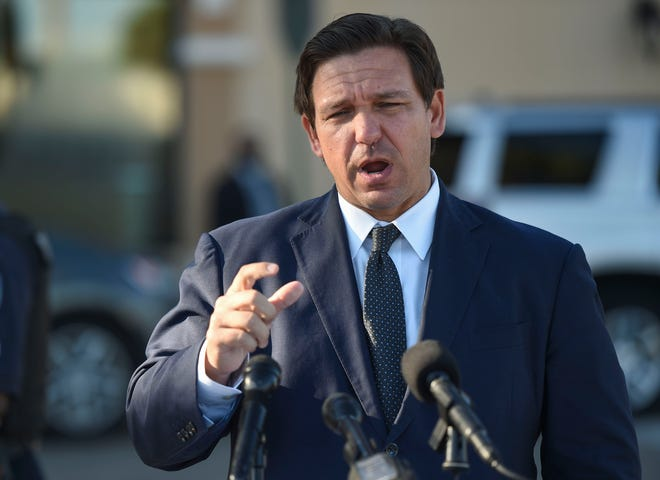 Florida Gov. Ron DeSantis holds a media briefing concerning the COVID-19 vaccines at the Publix Supermarket at Treasure Coast Plaza on Jan. 26 in Vero Beach. DeSantis said Monday that nearly 30% of Florida seniors have been vaccinated, but there are lingering recriminations about how the vaccination process unfolded for elder care facilities.
