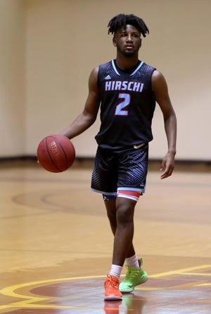 Hirschi's D'marion Gatewood dribbles in the game against Burkburnett Monday, Jan. 25, 2021, in D.L. Ligon Coliseum at Midwestern State University.