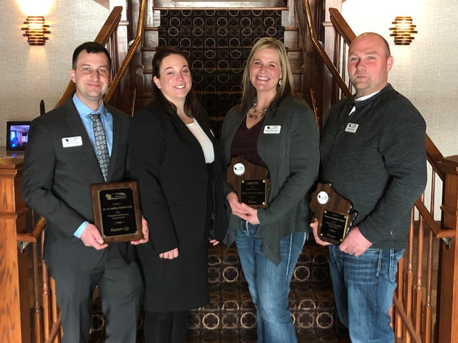 """Winners of the Outstanding Young Farmer competition in Neenah last weekend are, from left,  runners  up Joe and Ashley Dudkiewicz of Crivitz, and Shane and Jennifer Sauer, Waterloo, winners of both the OYF competition and the """"Speak up for Agriculture"""" award."""