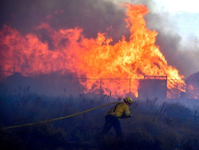 Battling a wildfire in Riverside, California, on Dec. 3, 2020.