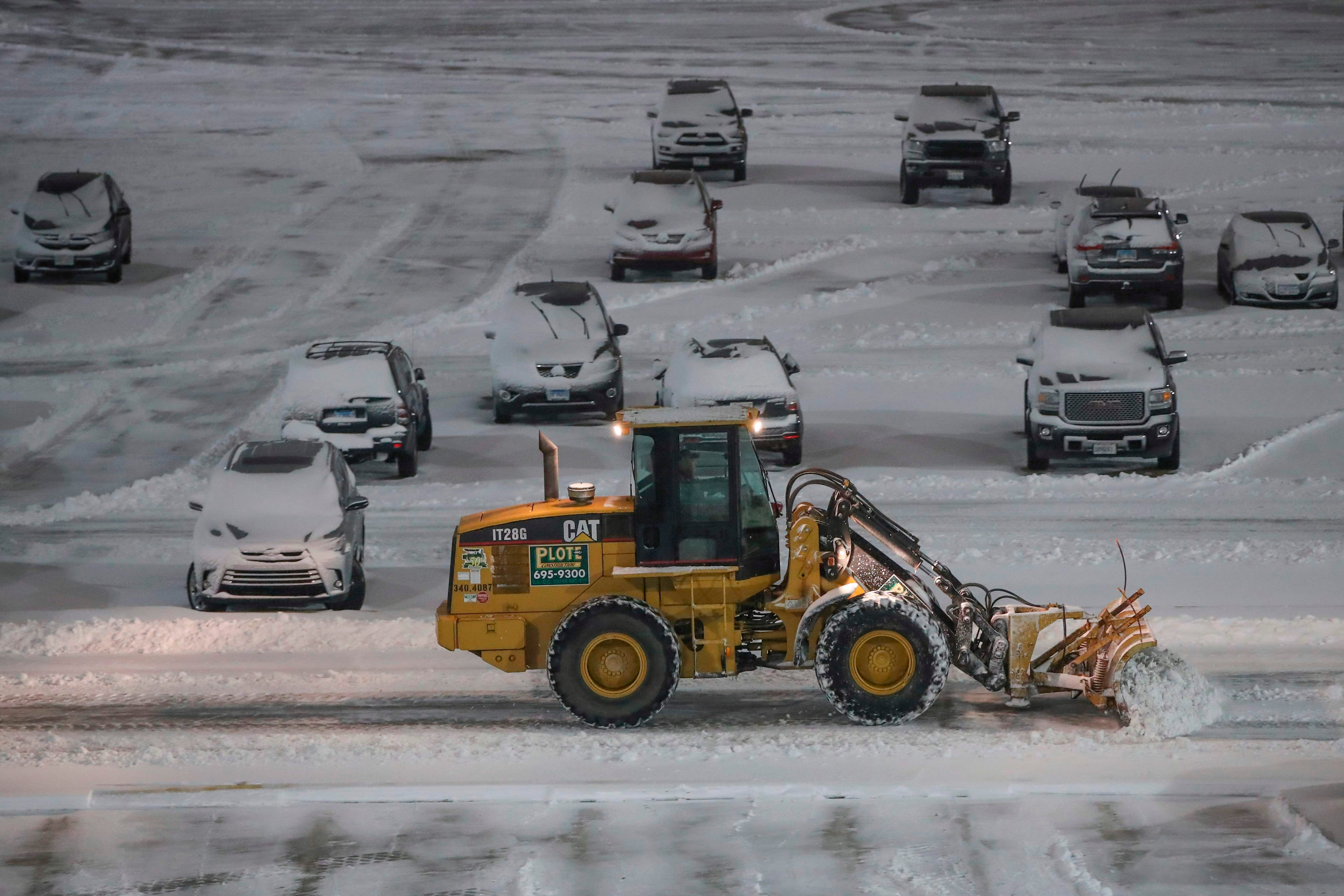 Airlines issue travel waivers as winter storms drops 'historic' snow in parts of Midwest