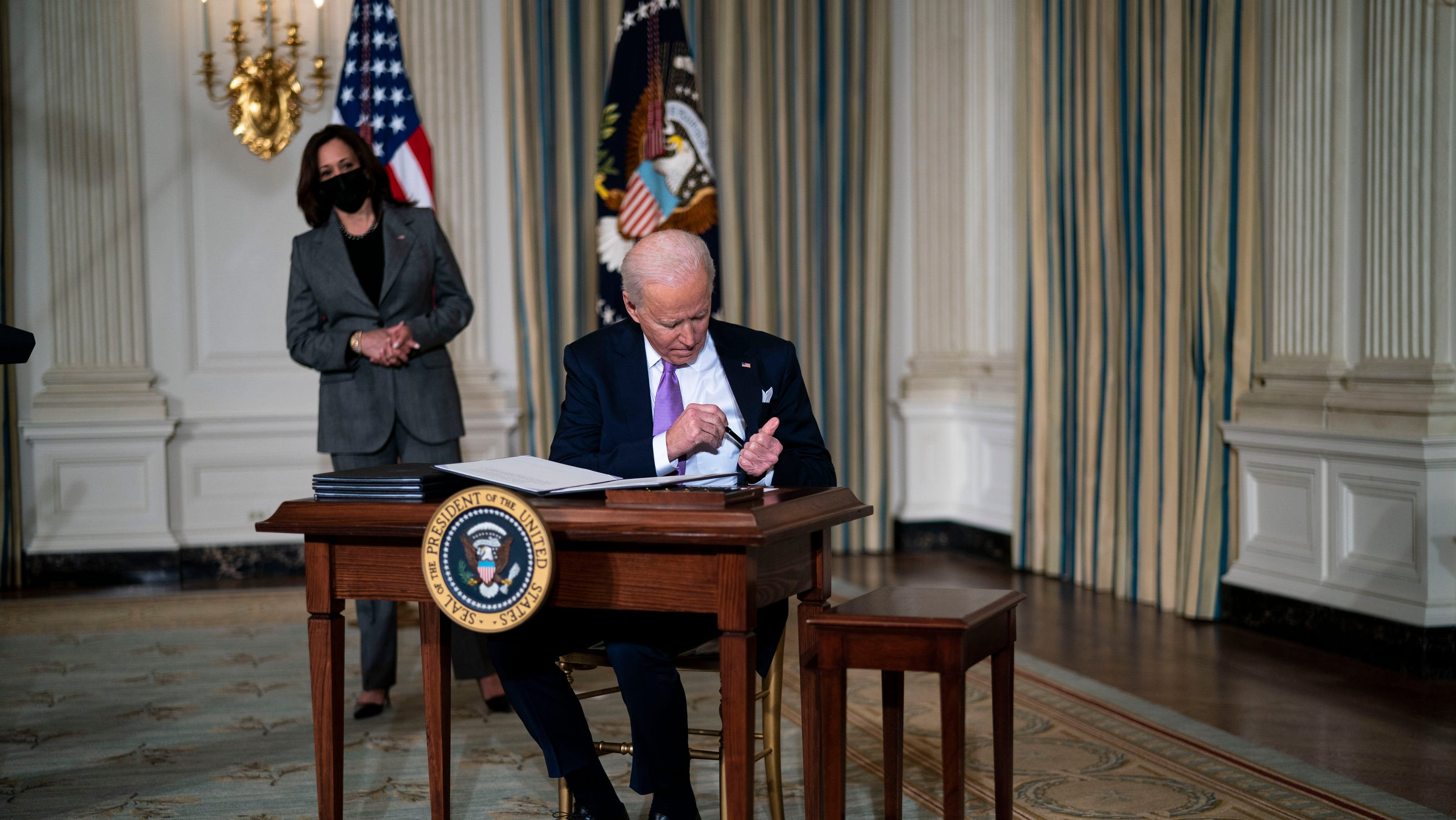 Biden addresses racial bias in housing, directs DOJ to phase out use of private prisons in new executive orders