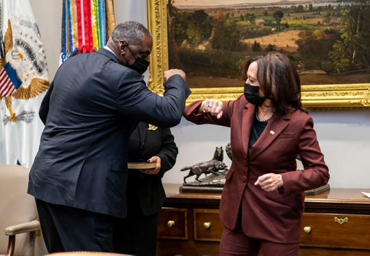 Secretary of Defense Lloyd Austin elbow bumps with Vice President Kamala Harris during his ceremonial swearing-in ceremony in the Roosevelt Room of the White House on Jan. 25, 2021.