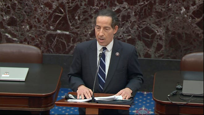 In this image from video, lead impeachment manager Rep. Jamie Raskin, D-Md., reads on the Senate floor the article of impeachment alleging incitement of insurrection against former President Donald Trump, in Washington, Monday, Jan. 25, 2021.